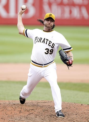 Jun 16, 2013; Pittsburgh, PA, USA; Pittsburgh Pirates relief pitcher Jason Grilli (39) pitches against the Los Angeles Dodgers during the ninth inning at PNC Park. The Pittsburgh Pirates won 6-3. Mandatory Credit: Charles LeClaire-USA TODAY Sports
