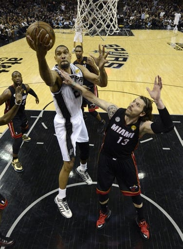 Jun 16, 2013; San Antonio, TX, USA; Miami Heat shooting guard Mike Miller (13) fouls San Antonio Spurs power forward Tim Duncan (21) during the fourth quarter of game five in the 2013 NBA Finals at the AT&T Center. Mandatory Credit: Brendan Maloney-USA TODAY Sports
