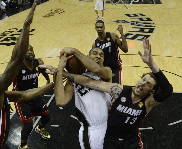 Jun 16, 2013; San Antonio, TX, USA; San Antonio Spurs power forward Tim Duncan (21) is fouled by Miami Heat shooting guard Mike Miller (13) during the fourth quarter of game five in the 2013 NBA Finals at the AT&T Center. Mandatory Credit: Brendan Maloney-USA TODAY Sports