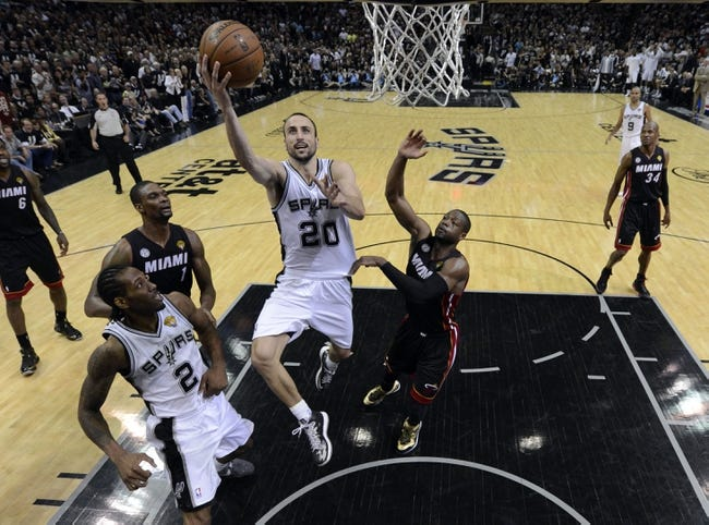 Jun 16, 2013; San Antonio, TX, USA; San Antonio Spurs shooting guard Manu Ginobili (20) lays the ball up  past Miami Heat shooting guard Dwyane Wade (3) during the fourth quarter of game five in the 2013 NBA Finals at the AT&T Center. Mandatory Credit: Brendan Maloney-USA TODAY Sports