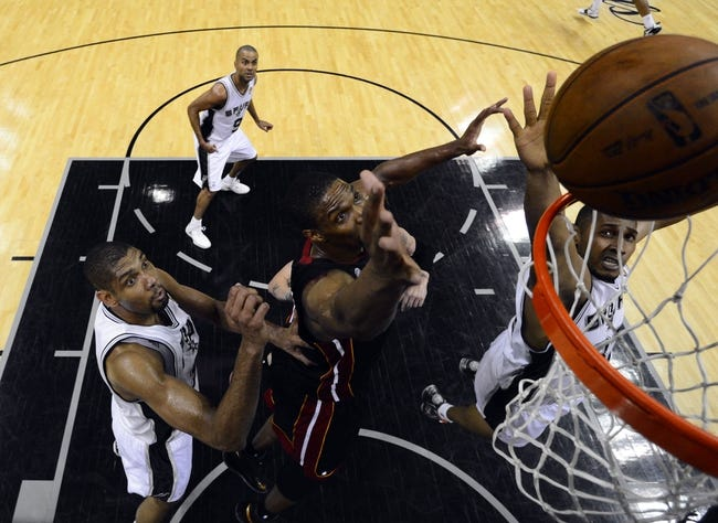 Jun 16, 2013; San Antonio, TX, USA; San Antonio Spurs center Boris Diaw (right) rebounds against Miami Heat center Chris Bosh (1) during the second half of game five in the 2013 NBA Finals at the AT&T Center. San Antonio Spurs won 114-104. Mandatory Credit: John G. Mabanglo/Pool Photo-USA TODAY Sports
