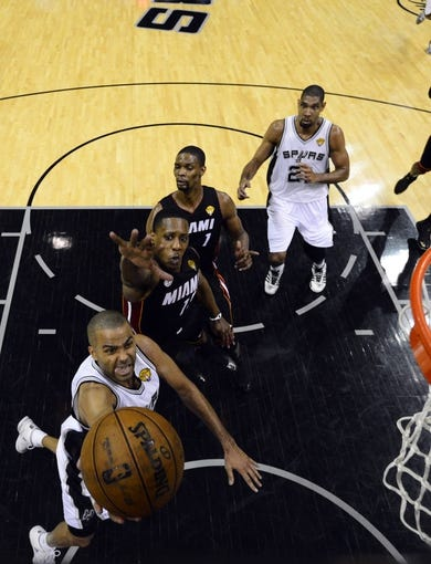 Jun 16, 2013; San Antonio, TX, USA; San Antonio Spurs point guard Tony Parker (9) shoots against Miami Heat point guard Mario Chalmers (15) during the second half of game five in the 2013 NBA Finals at the AT&T Center. San Antonio Spurs won 114-104. Mandatory Credit: John G. Mabanglo/Pool Photo-USA TODAY Sports