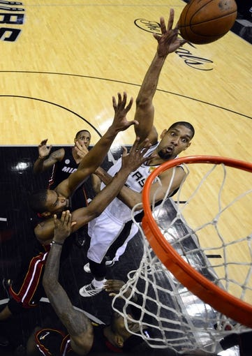 Jun 16, 2013; San Antonio, TX, USA; San Antonio Spurs power forward Tim Duncan (21) shoots against Miami Heat center Chris Bosh (1) during the second half of game five in the 2013 NBA Finals at the AT&T Center. San Antonio Spurs won 114-104. Mandatory Credit: John G. Mabanglo/Pool Photo-USA TODAY Sports