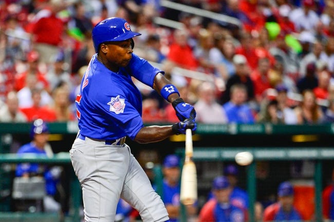 Jun 17, 2013; St. Louis, MO, USA; Chicago Cubs left fielder Alfonso Soriano (12) strikes out to end the 1st inning against the St. Louis Cardinals at Busch Stadium. Mandatory Credit: Scott Rovak-USA TODAY Sports