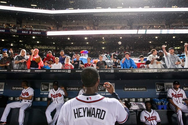 June 17, 2012; Atlanta, GA, USA; Atlanta Braves right fielder Jason Heyward (22) signs autographs during a rain delay before the gam against the New York Mets at Turner Field. Mandatory Credit: Daniel Shirey-USA TODAY Sports