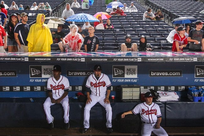 June 17, 2012; Atlanta, GA, USA; Atlanta Braves starting pitcher Julio Teheran (49), third baseman Ramiro Pena (14) and starting pitcher Kris Medlen (54) sit in the dugout during a rain delay before the game against the New York Mets at Turner Field. Mandatory Credit: Daniel Shirey-USA TODAY Sports
