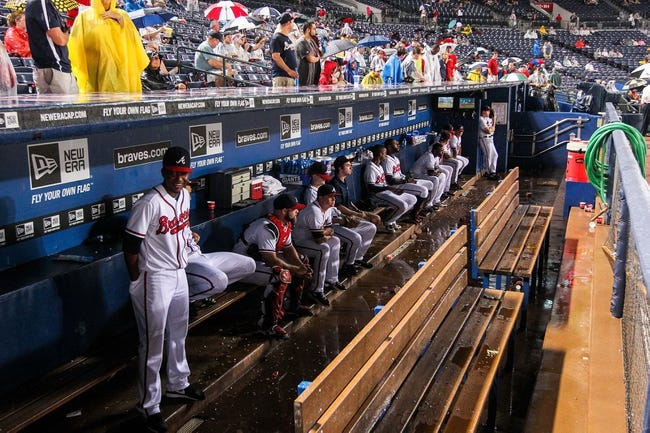 June 17, 2012; Atlanta, GA, USA; The Atlanta Braves sit in the dugout during a rain delay before the game against the New York Mets at Turner Field. Mandatory Credit: Daniel Shirey-USA TODAY Sports