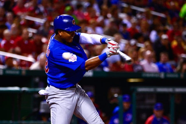 Jun 17, 2013; St. Louis, MO, USA; Chicago Cubs shortstop Starlin Castro (13) strikes out against the St. Louis Cardinals at Busch Stadium. Mandatory Credit: Scott Rovak-USA TODAY Sports