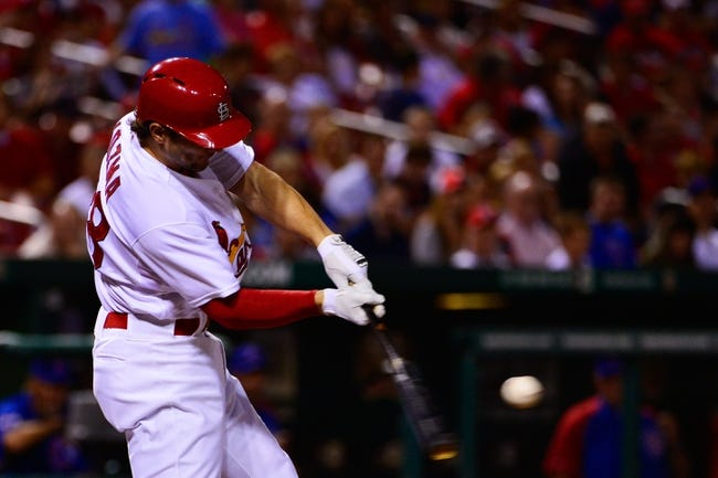 Jun 17, 2013; St. Louis, MO, USA; St. Louis Cardinals shortstop Pete Kozma (38) hits a double against the Chicago Cubs during the third inning at Busch Stadium. Mandatory Credit: Scott Rovak-USA TODAY Sports