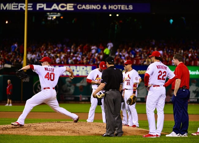 Jun 17, 2013; St. Louis, MO, USA; St. Louis Cardinals starting pitcher Shelby Miller (40) attempts to pitch after experiencing cramping in his right leg against the Chicago Cubs at Busch Stadium. Miller left the game in the 5th inning. Mandatory Credit: Scott Rovak-USA TODAY Sports