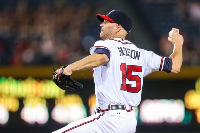 June 17, 2012; Atlanta, GA, USA; Atlanta Braves starting pitcher Tim Hudson (15) pitches in the second inning against the New York Mets at Turner Field. Mandatory Credit: Daniel Shirey-USA TODAY Sports