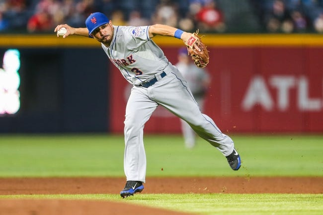 June 17, 2012; Atlanta, GA, USA; New York Mets shortstop Omar Quintanilla (3) throws to first for an out in the third inning against the Atlanta Braves at Turner Field. Mandatory Credit: Daniel Shirey-USA TODAY Sports