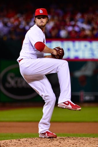 Jun 17, 2013; St. Louis, MO, USA; St. Louis Cardinals relief pitcher Kevin Siegrist (46) delivers a pitch against the Chicago Cubs during the sixth inning at Busch Stadium. Mandatory Credit: Scott Rovak-USA TODAY Sports