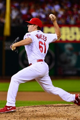 Jun 17, 2013; St. Louis, MO, USA; St. Louis Cardinals relief pitcher Seth Maness (61) delivers a pitch against the Chicago Cubs at Busch Stadium. Mandatory Credit: Scott Rovak-USA TODAY Sports