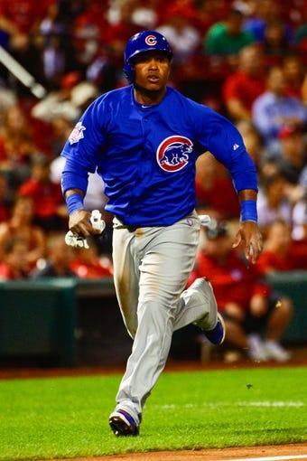 Jun 17, 2013; St. Louis, MO, USA; Chicago Cubs third baseman Luis Valbuena (24) scores a run against the St. Louis Cardinals during the eighth inning at Busch Stadium. Mandatory Credit: Scott Rovak-USA TODAY Sports