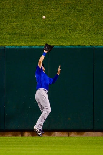 Jun 17, 2013; St. Louis, MO, USA; Chicago Cubs right fielder Ryan Sweeney (6) makes a catch on a ball hit by St. Louis Cardinals third baseman David Freese (not pictured) to end the eighth inning at Busch Stadium. Mandatory Credit: Scott Rovak-USA TODAY Sports