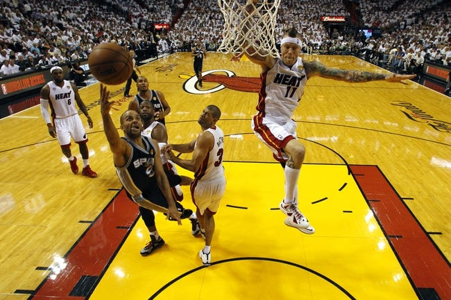 Jun 18, 2013; Miami, FL, USA; San Antonio Spurs point guard Tony Parker (9) shoots against Miami Heat small forward Shane Battier (31) during the second half of game six in the 2013 NBA Finals at American Airlines Arena. Mandatory Credit: Mike SegarPool Photo-USA TODAY Sports