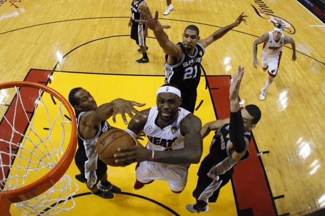 Jun 18, 2013; Miami, FL, USA; Miami Heat small forward LeBron James (6) drives to the basket against San Antonio Spurs small forward Kawhi Leonard (2) and shooting guard Danny Green (4) during the second half of game six in the 2013 NBA Finals at American Airlines Arena. Mandatory Credit: Kevin C. CoxPool Photo-USA TODAY Sports