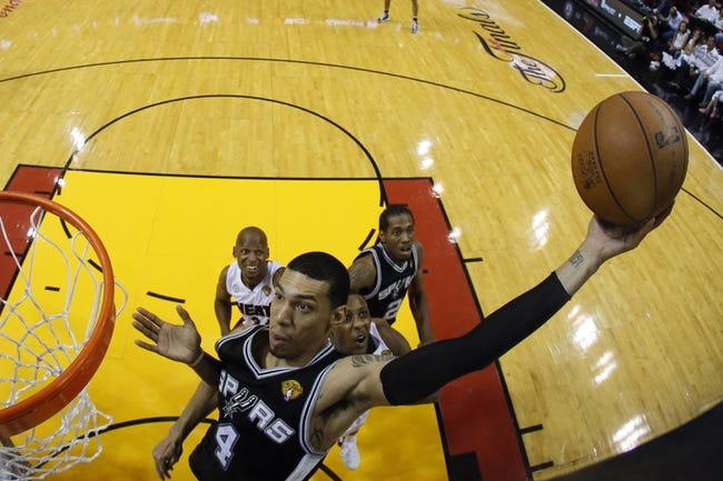 Jun 18, 2013; Miami, FL, USA; San Antonio Spurs shooting guard Danny Green (4) rebounds against the Miami Heat during the second half of game six in the 2013 NBA Finals at American Airlines Arena. Mandatory Credit: Kevin C. CoxPool Photo-USA TODAY Sports