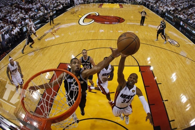 Jun 18, 2013; Miami, FL, USA; Miami Heat shooting guard Ray Allen (34) shoots against San Antonio Spurs power forward Tim Duncan (21) during the second half of game six in the 2013 NBA Finals at American Airlines Arena. Mandatory Credit: Kevin C. CoxPool Photo-USA TODAY Sports