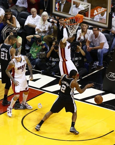 Jun 18, 2013; Miami, FL, USA;  Miami Heat small forward LeBron James (6) dunks as San Antonio Spurs power forward Tim Duncan (21) small forward Kawhi Leonard (2) and Heat power forward Chris Andersen (11) look on during the fourth quarter of game six in the 2013 NBA Finals at American Airlines Arena.  Mandatory Credit: Robert Mayer-USA TODAY Sports
