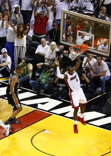 Jun 18, 2013; Miami, FL, USA;  Miami Heat small forward LeBron James (6) dunks as San Antonio Spurs power forward Tim Duncan (21) looks on during the fourth quarter of game six in the 2013 NBA Finals at American Airlines Arena.  Mandatory Credit: Robert Mayer-USA TODAY Sports