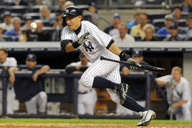 Jun 19, 2013; Bronx, NY, USA; New York Yankees right fielder Ichiro Suzuki (31) bunts against the Los Angeles Dodgers during the fifth inning of the second game of a doubleheader at Yankee Stadium. Suzuki was out on the play. Mandatory Credit: Brad Penner-USA TODAY Sports