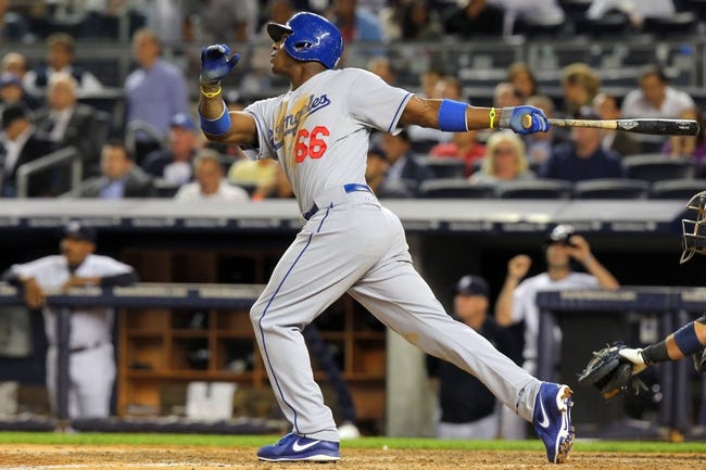 Jun 19, 2013; Bronx, NY, USA; Los Angeles Dodgers right fielder Yasiel Puig (66) hits a solo home run against the New York Yankees during the seventh inning of the second game of a doubleheader at Yankee Stadium. Mandatory Credit: Brad Penner-USA TODAY Sports