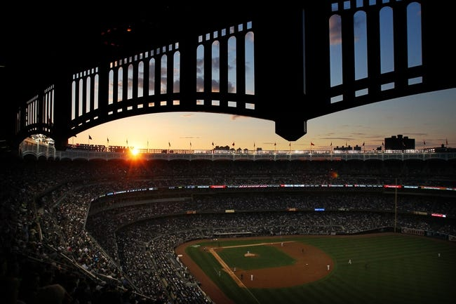 Jun 19, 2013; Bronx, NY, USA; General view of sunset at Yankee Stadium during the fourth inning of the second game of a doubleheader between the Los Angeles Dodgers and the New York Yankees at Yankee Stadium. Mandatory Credit: Brad Penner-USA TODAY Sports