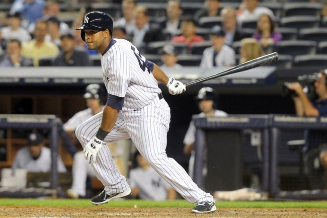 Jun 19, 2013; Bronx, NY, USA; New York Yankees right fielder Zoilo Almonte (45) grounds out to third as he makes his major league debut against the Los Angeles Dodgers during the ninth inning of the second game of a doubleheader at Yankee Stadium. Mandatory Credit: Brad Penner-USA TODAY Sports