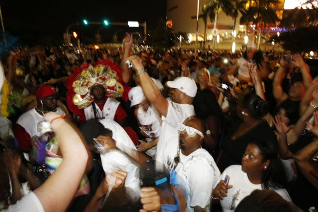 Jun 20, 2013; Miami, FL, USA; Miami Heat fans celebrate outside the arena following game seven in the 2013 NBA Finals at American Airlines Arena. Miami defeated the San Antonio Spurs 95-88 to win the NBA Championship. Mandatory Credit: Robert Mayer-USA TODAY Sports