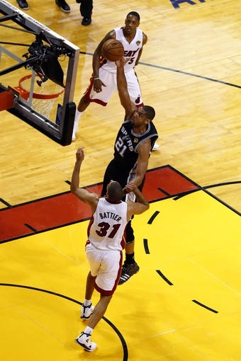Jun 20, 2013; Miami, FL, USA; San Antonio Spurs power forward Tim Duncan (21) shoots against Miami Heat small forward Shane Battier (31) during the fourth quarter of game seven in the 2013 NBA Finals at American Airlines Arena. Miami defeated San Antonio 95-88 to win the NBA Championship. Mandatory Credit: Robert Mayer-USA TODAY Sports