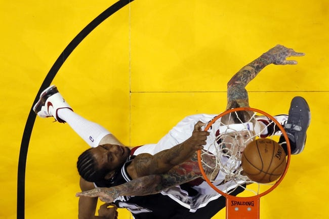 Jun 20, 2013; Miami, FL, USA; San Antonio Spurs small forward Kawhi Leonard (2) dunks against Miami Heat power forward Chris Andersen (11) during game seven in the 2013 NBA Finals at American Airlines Arena. Mandatory Credit: Mike Erhmann-Getty/Pool Photo via USA TODAY Sports