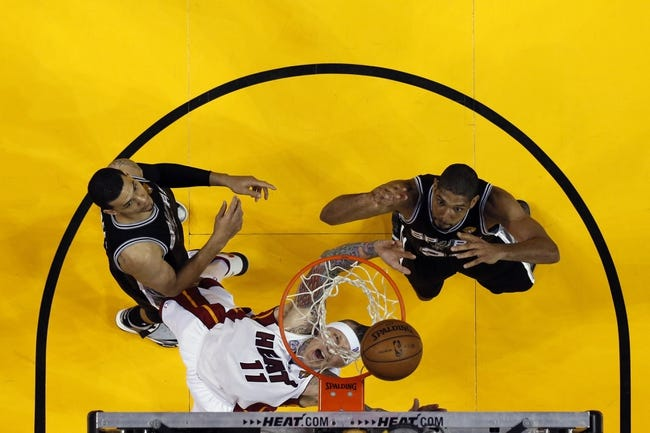 Jun 20, 2013; Miami, FL, USA; Miami Heat power forward Chris Andersen (11) rebounds against San Antonio Spurs power forward Tim Duncan (right) and shooting guard Danny Green (left) during game seven in the 2013 NBA Finals at American Airlines Arena. Mandatory Credit: Mike Erhmann-Getty/Pool Photo via USA TODAY Sports