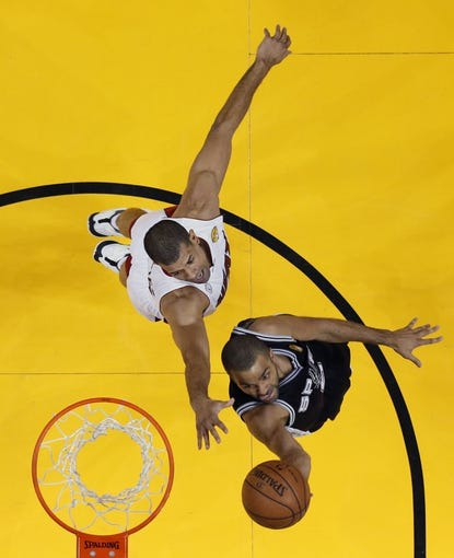 Jun 20, 2013; Miami, FL, USA; San Antonio Spurs point guard Tony Parker (9) shoots against Miami Heat small forward Shane Battier (31) during game seven in the 2013 NBA Finals at American Airlines Arena. Mandatory Credit: Mike Erhmann-Getty/Pool Photo via USA TODAY Sports