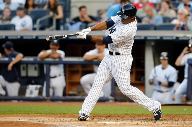 Jun 21, 2013; Bronx, NY, USA;  New York Yankees right fielder Zoilo Almonte (45) singles to center during the second inning against the Tampa Bay Rays at Yankee Stadium.  Mandatory Credit: Anthony Gruppuso-USA TODAY Sports