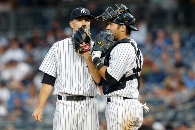 Jun 21, 2013; Bronx, NY, USA;  New York Yankees catcher Austin Romine (53) visits starting pitcher David Phelps (41) on the mound during the fourth inning against the Tampa Bay Rays at Yankee Stadium.  Mandatory Credit: Anthony Gruppuso-USA TODAY Sports