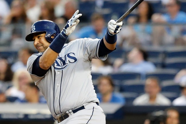 Jun 21, 2013; Bronx, NY, USA;  Tampa Bay Rays catcher Jose Molina (28) singles to left during the fourth inning against the New York Yankees at Yankee Stadium.  Mandatory Credit: Anthony Gruppuso-USA TODAY Sports