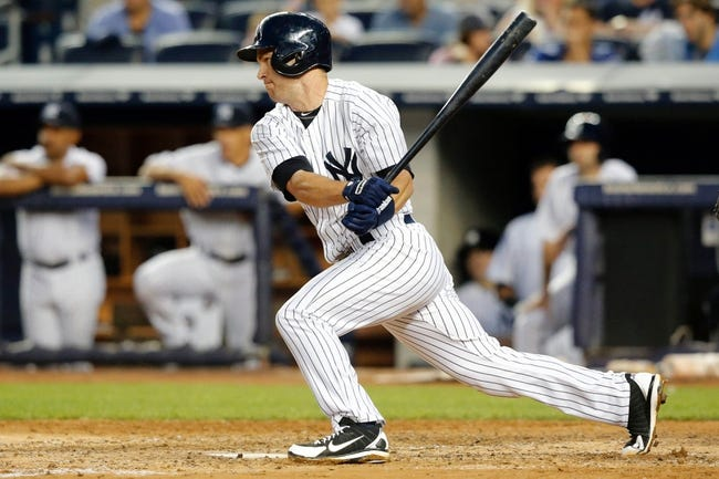 Jun 21, 2013; Bronx, NY, USA;  New York Yankees shortstop Jayson Nix (17) grounds into a double play allowing a runner to score during the fourth inning against the Tampa Bay Rays at Yankee Stadium.  Mandatory Credit: Anthony Gruppuso-USA TODAY Sports