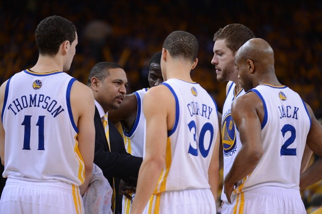May 16, 2013; Oakland, CA, USA; Golden State Warriors head coach Mark Jackson (second from left) instructs his team in a huddle during the fourth quarter in game six of the second round of the 2013 NBA Playoffs against the San Antonio Spurs at Oracle Arena. The Spurs defeated the Warriors 94-82.  Mandatory Credit: Kyle Terada-USA TODAY Sports