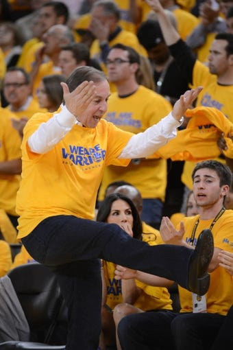 May 16, 2013; Oakland, CA, USA; Golden State Warriors owner Joe Lacob reacts during the third quarter in game six of the second round of the 2013 NBA Playoffs against the San Antonio Spurs at Oracle Arena. The Spurs defeated the Warriors 94-82.  Mandatory Credit: Kyle Terada-USA TODAY Sports