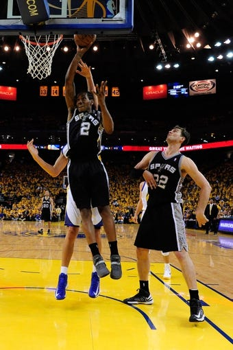 May 16, 2013; Oakland, CA, USA; San Antonio Spurs small forward Kawhi Leonard (2) shoots the ball during the third quarter in game six of the second round of the 2013 NBA Playoffs against the Golden State Warriors at Oracle Arena. The Spurs defeated the Warriors 94-82.  Mandatory Credit: Kyle Terada-USA TODAY Sports