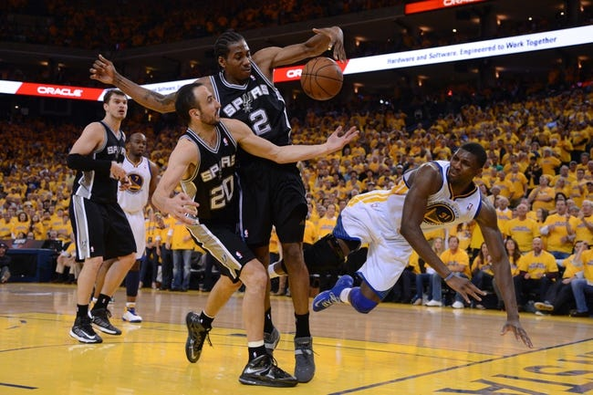 May 16, 2013; Oakland, CA, USA; San Antonio Spurs shooting guard Manu Ginobili (20) and small forward Kawhi Leonard (2) grab a rebound against Golden State Warriors center Festus Ezeli (31) during the fourth quarter in game six of the second round of the 2013 NBA Playoffs at Oracle Arena. The Spurs defeated the Warriors 94-82.  Mandatory Credit: Kyle Terada-USA TODAY Sports