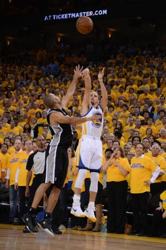 May 16, 2013; Oakland, CA, USA; Golden State Warriors point guard Stephen Curry (30, right) shoots the ball against San Antonio Spurs point guard Tony Parker (9, left) during the fourth quarter in game six of the second round of the 2013 NBA Playoffs at Oracle Arena. The Spurs defeated the Warriors 94-82.  Mandatory Credit: Kyle Terada-USA TODAY Sports