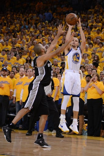 May 16, 2013; Oakland, CA, USA; Golden State Warriors point guard Stephen Curry (30) shoots the ball against San Antonio Spurs point guard Tony Parker (9) during the fourth quarter in game six of the second round of the 2013 NBA Playoffs at Oracle Arena. The Spurs defeated the Warriors 94-82.  Mandatory Credit: Kyle Terada-USA TODAY Sports