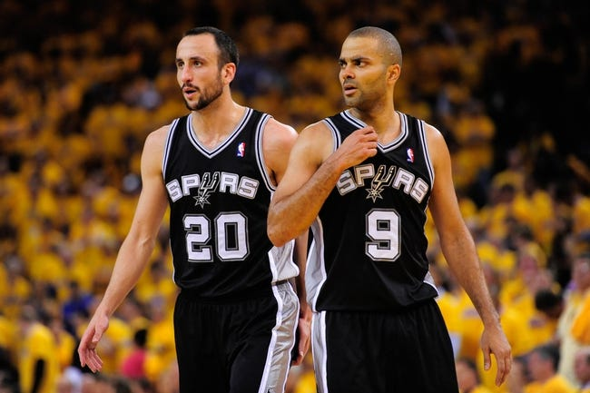May 16, 2013; Oakland, CA, USA; San Antonio Spurs shooting guard Manu Ginobili (20) and point guard Tony Parker (9) look on during the fourth quarter in game six of the second round of the 2013 NBA Playoffs against the Golden State Warriors at Oracle Arena. The Spurs defeated the Warriors 94-82.  Mandatory Credit: Kyle Terada-USA TODAY Sports
