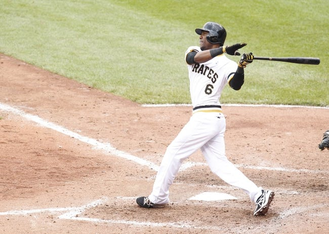 Jun 16, 2013; Pittsburgh, PA, USA; Pittsburgh Pirates pinch hitter Starling Marte (6) bats against the Los Angeles Dodgers during the sixth inning at PNC Park. The Pittsburgh Pirates won 6-3. Mandatory Credit: Charles LeClaire-USA TODAY Sports