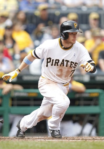 Jun 16, 2013; Pittsburgh, PA, USA; Pittsburgh Pirates left fielder Alex Presley (7) runs to first base after hitting the ball against the Los Angeles Dodgers during the fourth inning at PNC Park. The Pittsburgh Pirates won 6-3. Mandatory Credit: Charles LeClaire-USA TODAY Sports