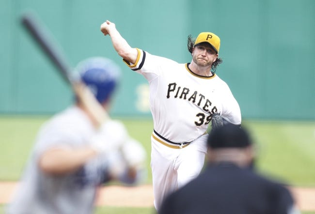 Jun 16, 2013; Pittsburgh, PA, USA; Pittsburgh Pirates relief pitcher Jason Grilli (39) pitches against Los Angeles Dodgers pinch hitter Mark Ellis (14) during the ninth inning at PNC Park. The Pittsburgh Pirates won 6-3. Mandatory Credit: Charles LeClaire-USA TODAY Sports