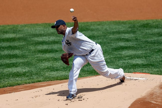 Jun 22, 2013; Bronx, NY, USA;   New York Yankees starting pitcher CC Sabathia (52) pitches during the first inning against the Tampa Bay Rays at Yankee Stadium.  Mandatory Credit: Anthony Gruppuso-USA TODAY Sports